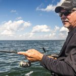 What characteristics make a good spinning rod and reel outfit for walleye fishing?